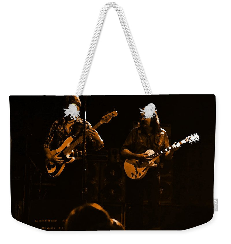 Marshall Tucker Weekender Tote Bag featuring the photograph Marshall Tucker Winterland 1975 #36 Enhanced In Amber by Ben Upham