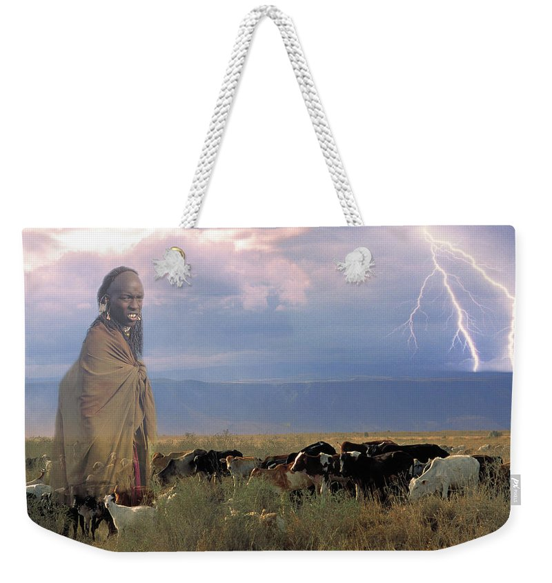 Cattle Weekender Tote Bag featuring the photograph Masaii Cattle by Don Schimmel