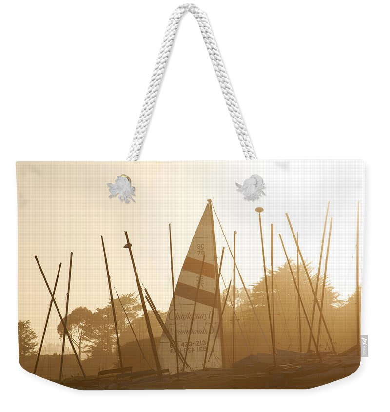 Ship Weekender Tote Bag featuring the photograph Mass Of Ships by Marilyn Hunt