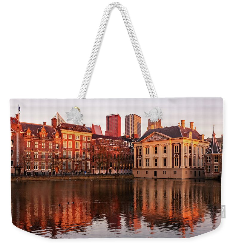 The Hague Weekender Tote Bag featuring the photograph Mauritshuis And Hofvijver At Golden Hour - The Hague by Barry O Carroll