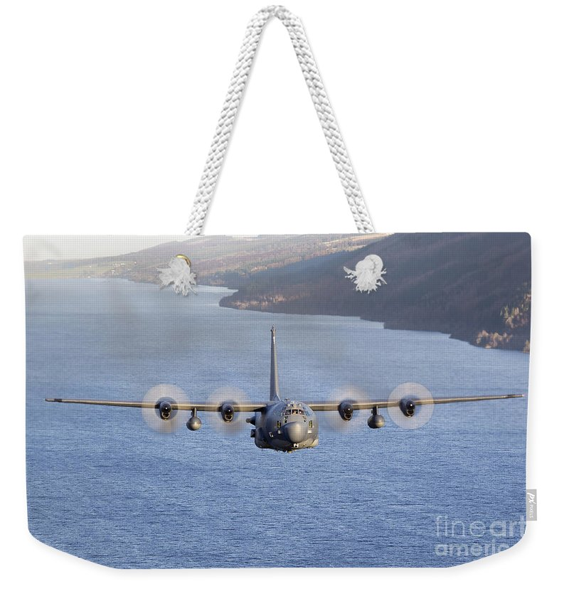 Transportation Weekender Tote Bag featuring the photograph Mc-130h Combat Talon II Over Loch Ness by Gert Kromhout