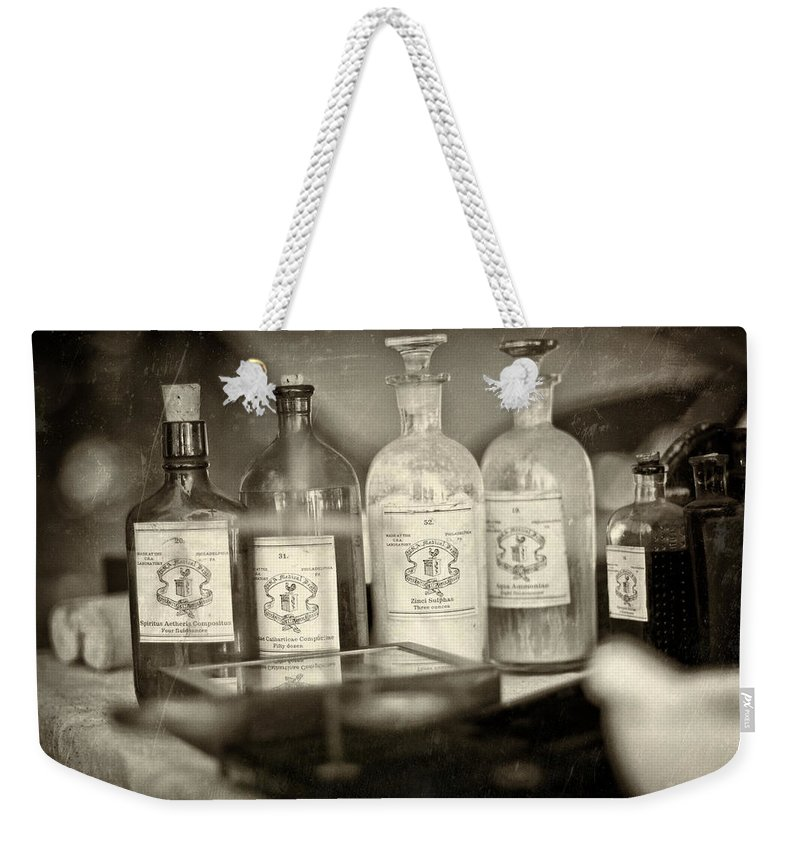 Medicine Weekender Tote Bag featuring the photograph Medicinal Remedy by Scott Wyatt