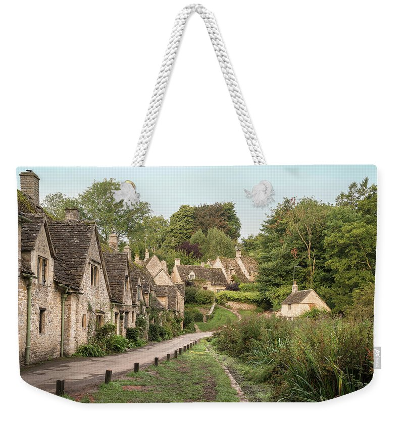 Arlington Row Weekender Tote Bag featuring the photograph Medieval Houses In Arlington Row In Cotswolds Countryside Landsc by Matthew Gibson