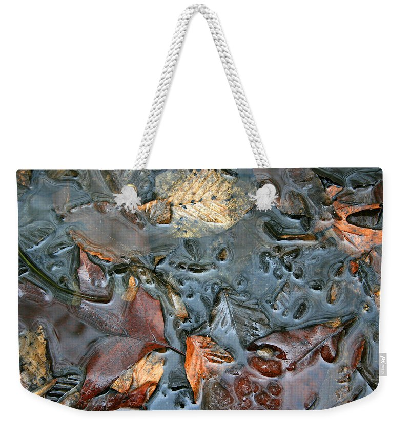 Nature Fall Leaf Leaves Colorful Water Melt Melted Reflect Reflection Outdoors Forest Woods Light Weekender Tote Bag featuring the photograph Melted Colors by Andrei Shliakhau