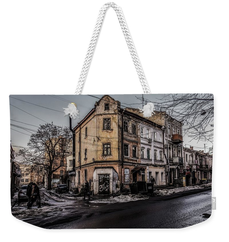 Odessa Weekender Tote Bag featuring the photograph Melting Snow by Reksik004
