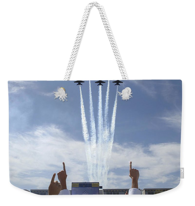Education Weekender Tote Bag featuring the photograph Members Of The U.s. Naval Academy Cheer by Stocktrek Images