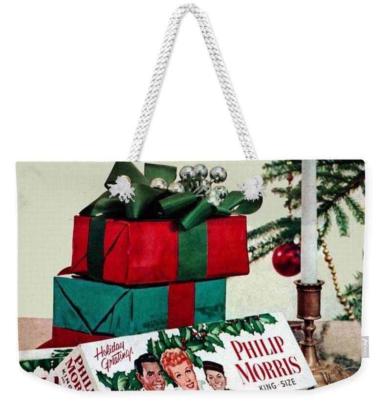 Merry Christmas Vintage Cigarette Advert Weekender Tote Bag featuring the painting Merry Christmas Vintage Cigarette Advert by R Muirhead Art