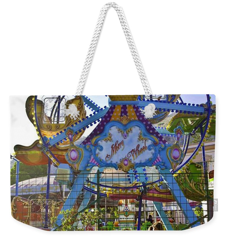 Amusement Park Weekender Tote Bag featuring the photograph Merry Wheel by Madeline Ellis