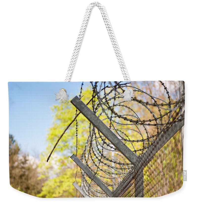 Barbed Weekender Tote Bag featuring the photograph Metal Sharp Barbed Wire by Arletta Cwalina