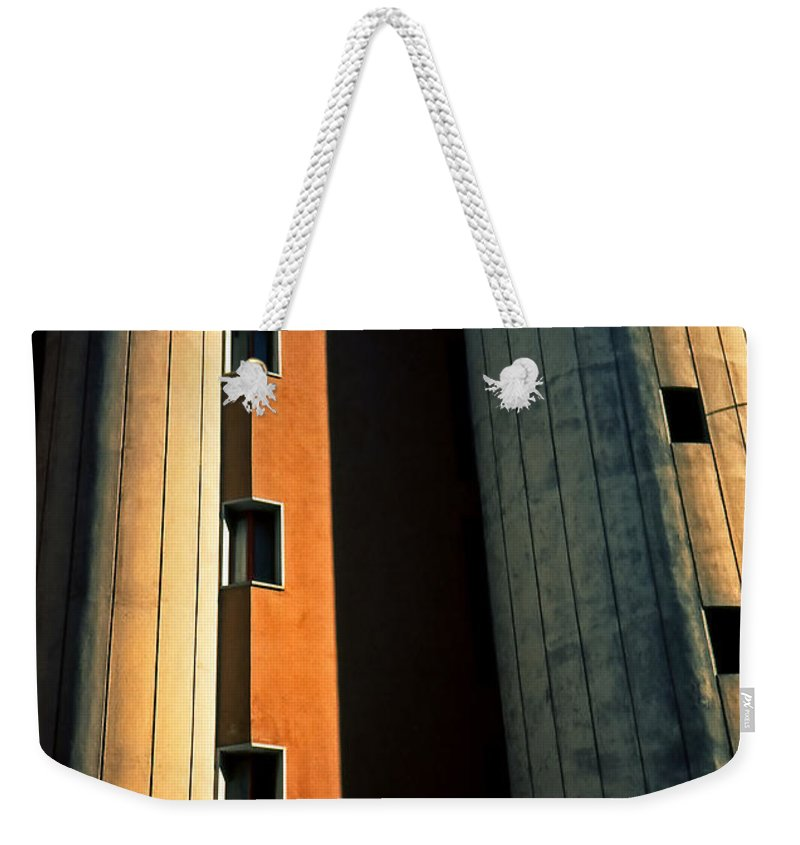 Metropolis Weekender Tote Bag featuring the photograph Metropolis by Silvia Ganora
