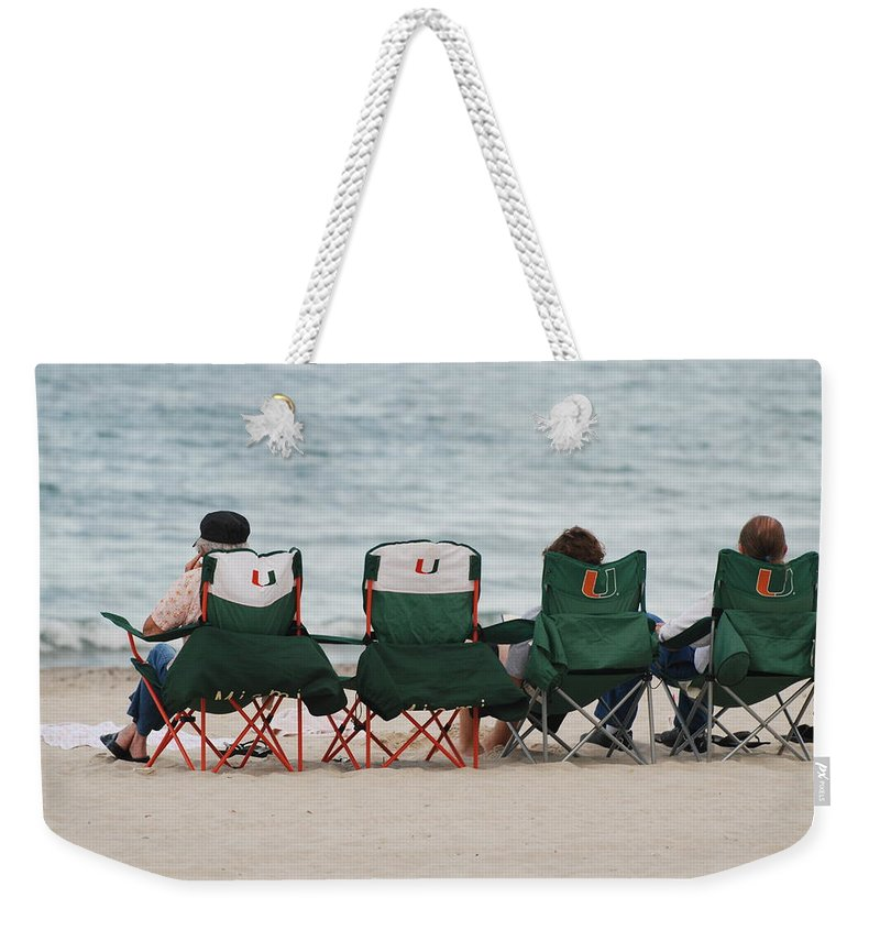 University Of Miami Weekender Tote Bag featuring the photograph Miami Hurricane Fans by Rob Hans