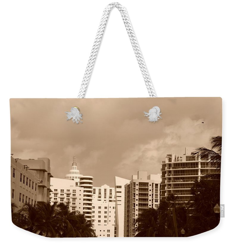 Sepia Weekender Tote Bag featuring the photograph Miami Sepia Sky by Rob Hans