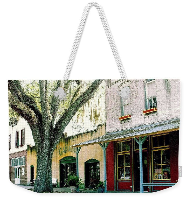 Micanopy Weekender Tote Bag featuring the photograph Micanopy Storefronts by Nelson Strong