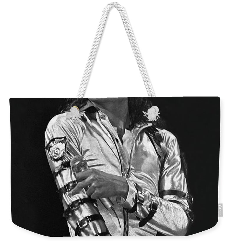 Music Legend Michael Jackson Is Shown Performing On Stage During A Live Concert Appearance Weekender Tote Bag featuring the photograph Michael Jackson - The King of Pop by Concert Photos