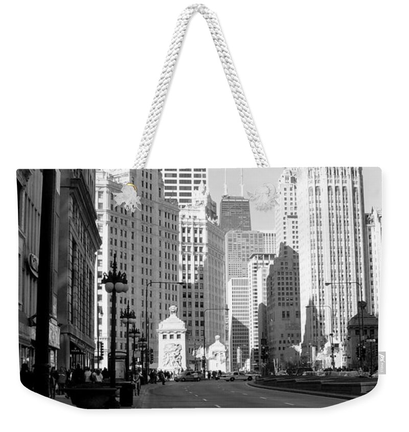 Chicago Weekender Tote Bag featuring the photograph Michigan Ave Tall B-w by Anita Burgermeister
