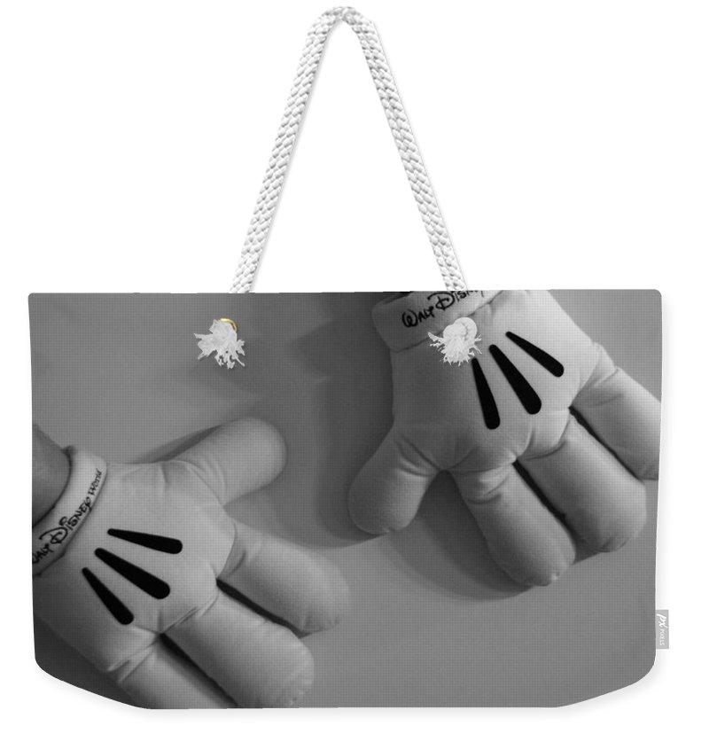 Black And White Weekender Tote Bag featuring the photograph Mickeys Hands by Rob Hans