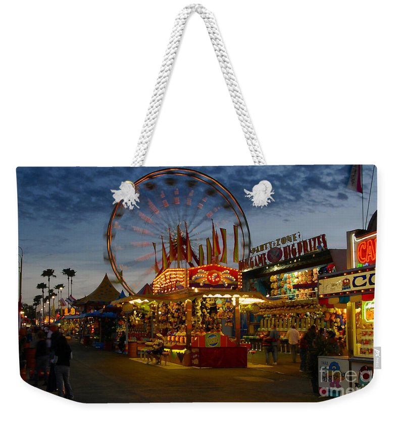 Midway Weekender Tote Bag featuring the photograph Midway by David Lee Thompson