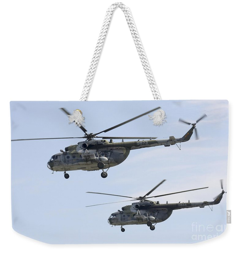 Horizontal Weekender Tote Bag featuring the photograph Mil Mi-17 Helicopters Of The Czech Air by Timm Ziegenthaler