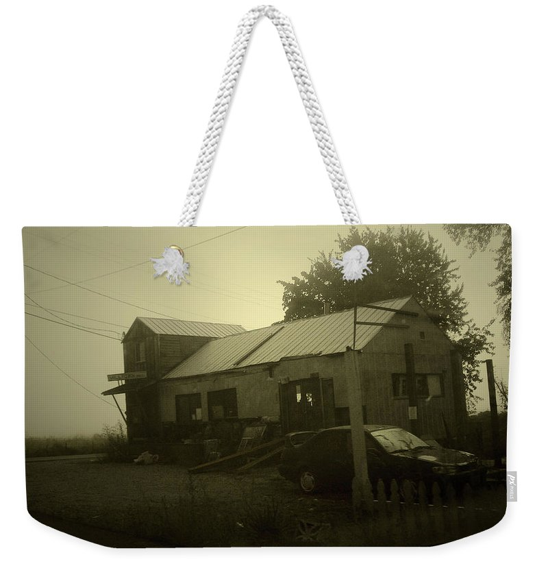 Milltown Weekender Tote Bag featuring the photograph Milltown Merchantile by Tim Nyberg