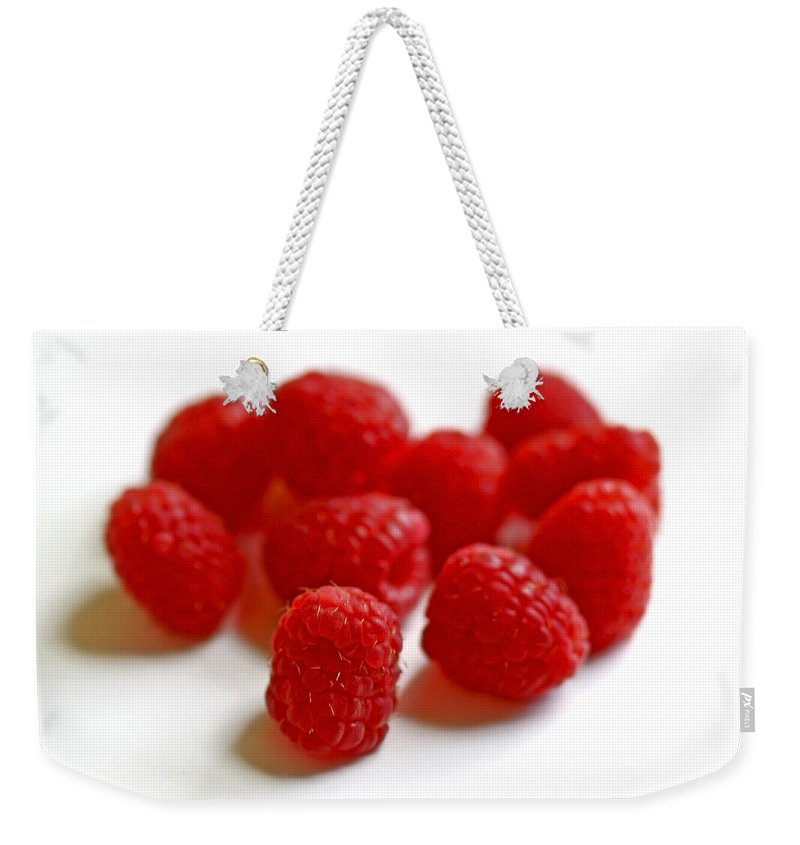 Raspberry Weekender Tote Bag featuring the photograph Mingling by Evelina Kremsdorf