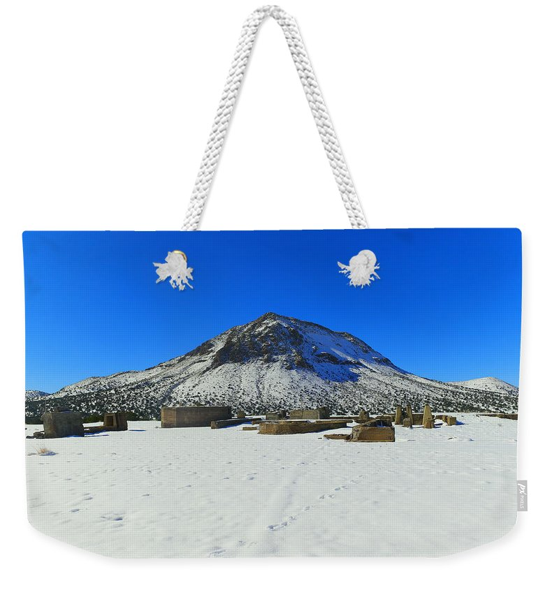 Mountain Weekender Tote Bag featuring the photograph Mining Ruins Foreground A Snowy Mountain by Jeff Swan