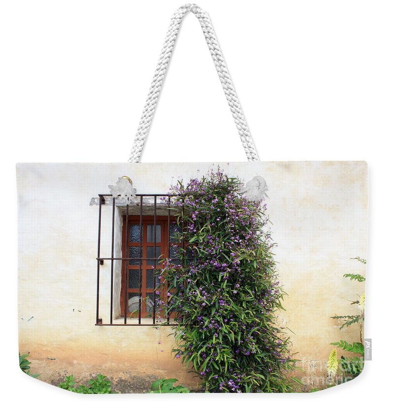 Purple Flowers Weekender Tote Bag featuring the photograph Mission Window With Purple Flowers by Carol Groenen