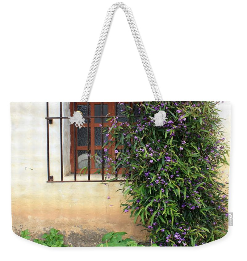 Mission Weekender Tote Bag featuring the photograph Mission Window With Purple Flowers Vertical by Carol Groenen