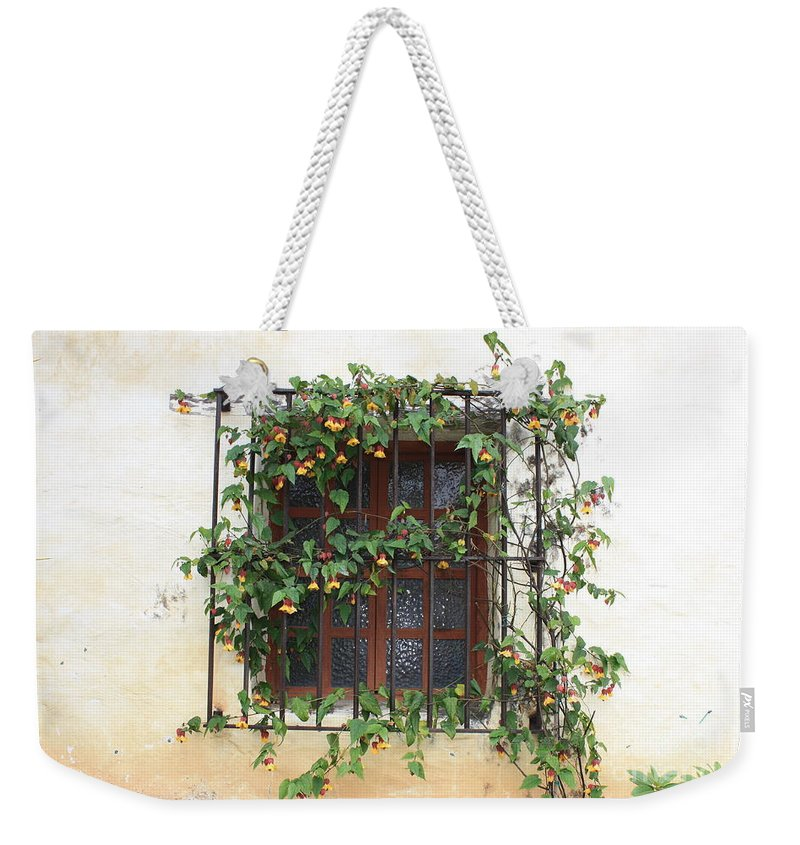 Window Weekender Tote Bag featuring the photograph Mission Window With Yellow Flowers by Carol Groenen