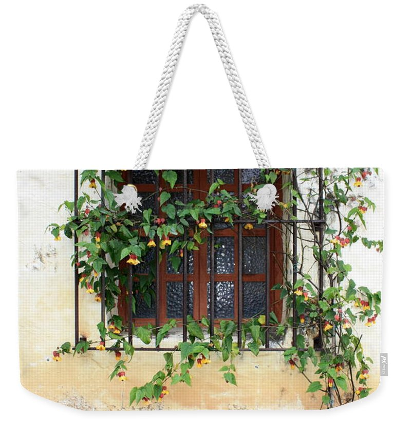 Mission Window Weekender Tote Bag featuring the photograph Mission Window With Yellow Flowers Vertical by Carol Groenen