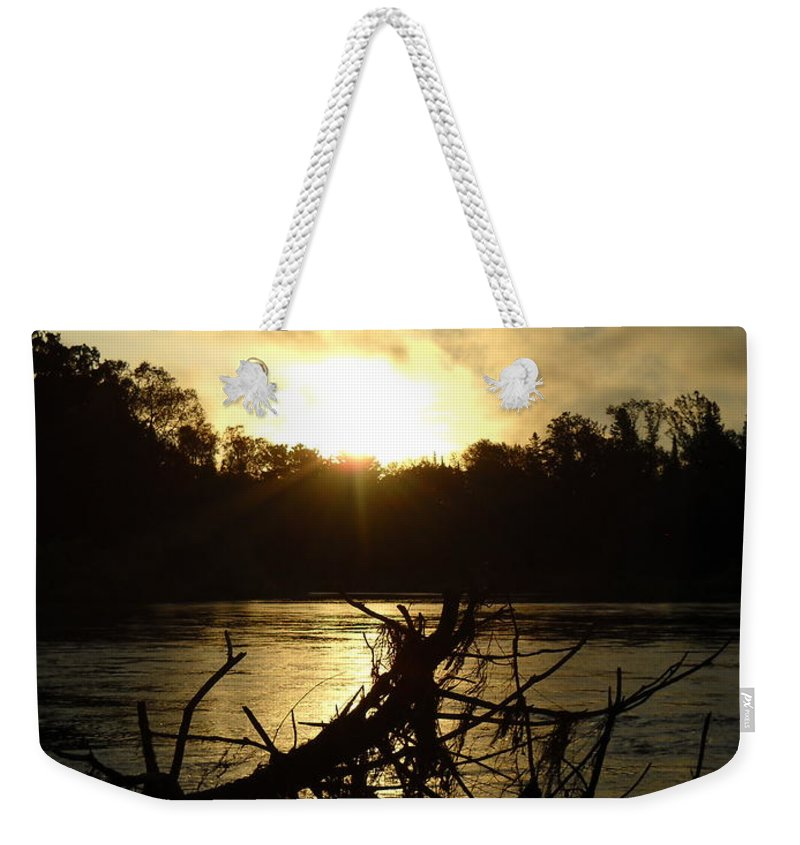 Mississippi River Weekender Tote Bag featuring the photograph Mississippi River Sunrise Tree Roots by Kent Lorentzen