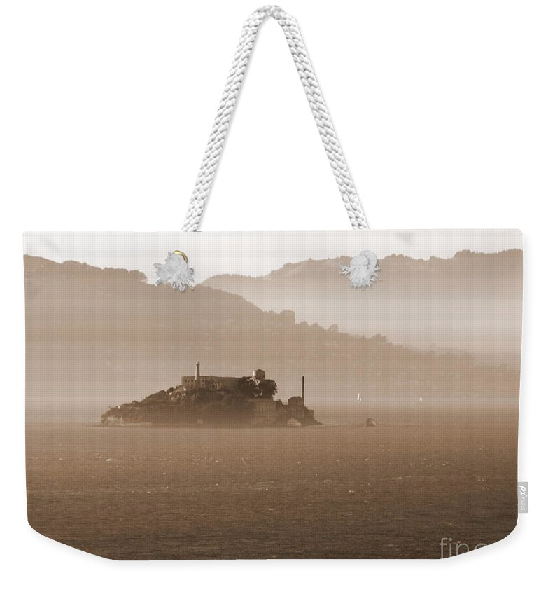 San Francisco Weekender Tote Bag featuring the photograph Misty Alcatraz by Carol Groenen