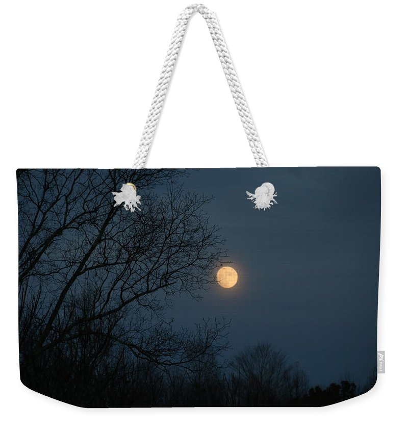 Moon Weekender Tote Bag featuring the photograph Misty Moonrise by Kathryn Meyer