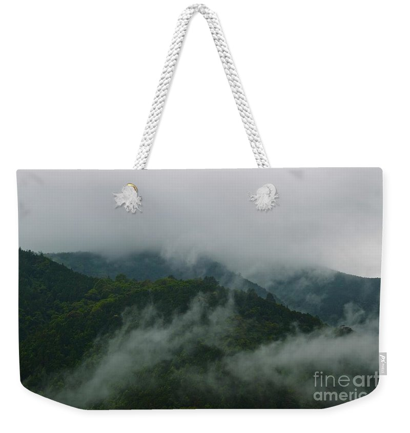 Forest Weekender Tote Bag featuring the photograph Misty Mountains by MingTa Li
