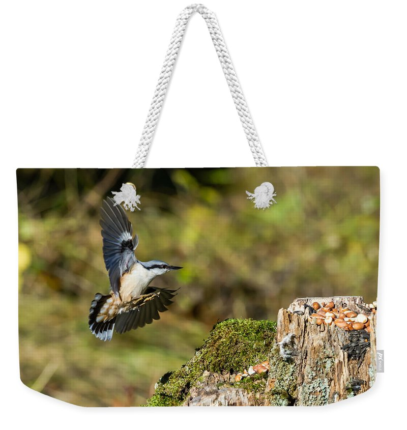 Nuthatch Weekender Tote Bag featuring the photograph Mmm Peanuts by Torbjorn Swenelius