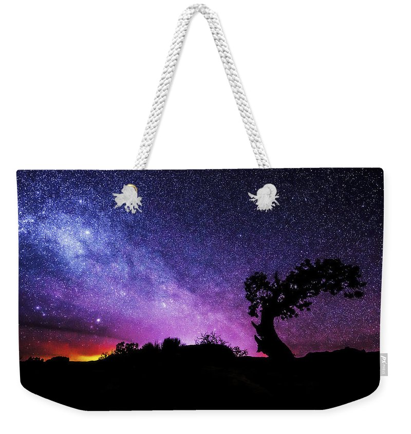 Moab Skies Weekender Tote Bag featuring the photograph Moab Skies by Chad Dutson