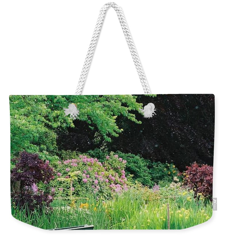 Monet Weekender Tote Bag featuring the photograph Monet's Garden Pond And Boat by Nadine Rippelmeyer