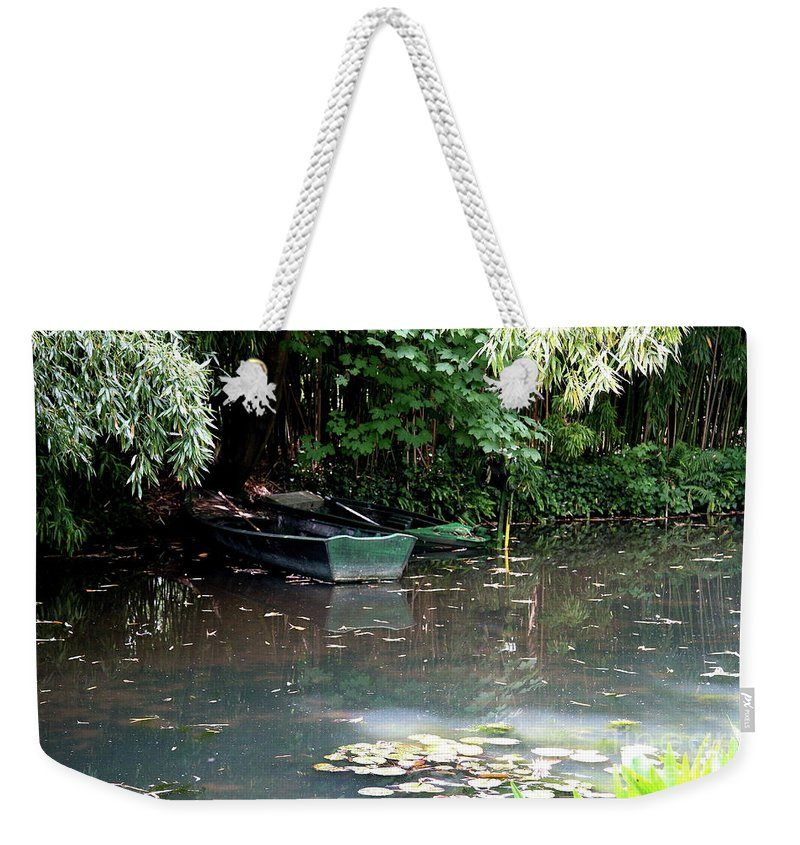 Pond Weekender Tote Bag featuring the photograph Monets Rowboats by Christiane Schulze Art And Photography