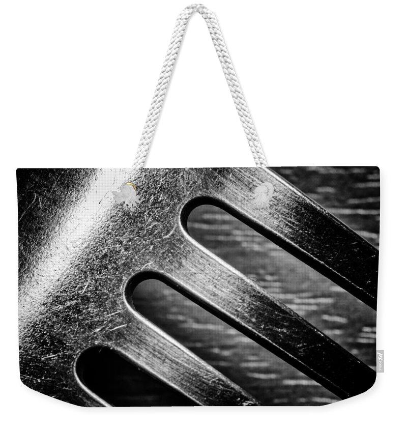 Monochrome Weekender Tote Bag featuring the photograph Monochrome Kitchen Fork Abstract by John Williams