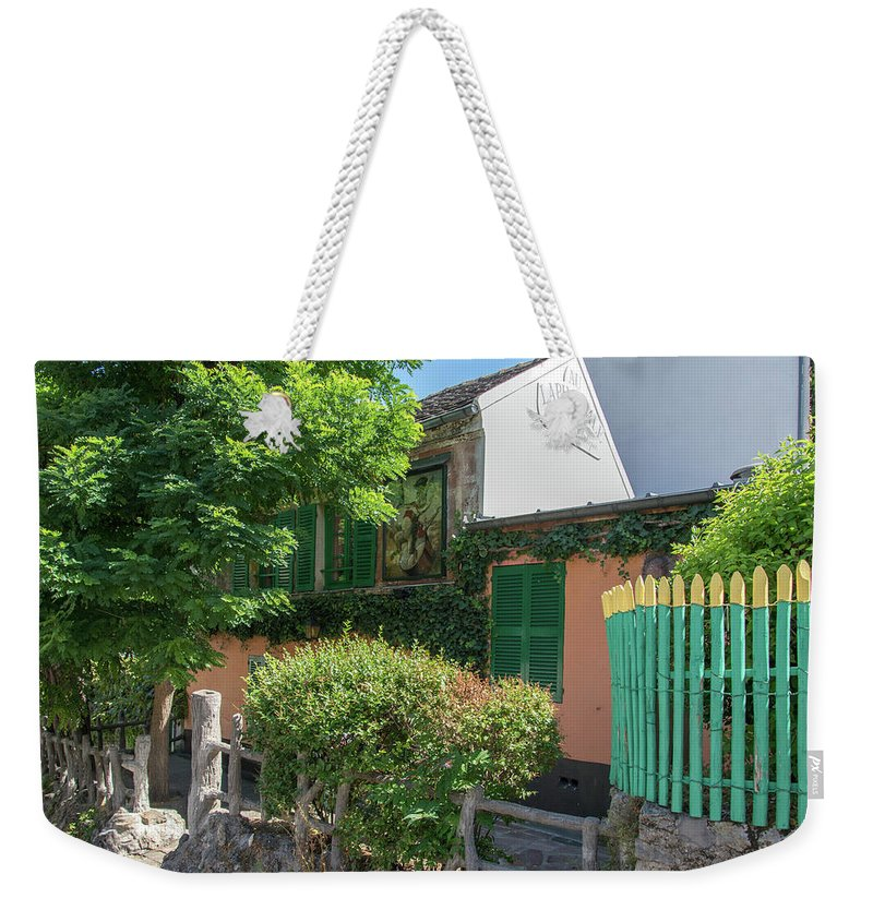 Artist On The Street Weekender Tote Bag featuring the digital art Montmarte Paris La Lapin Agile Cabaret by Carol Ailles