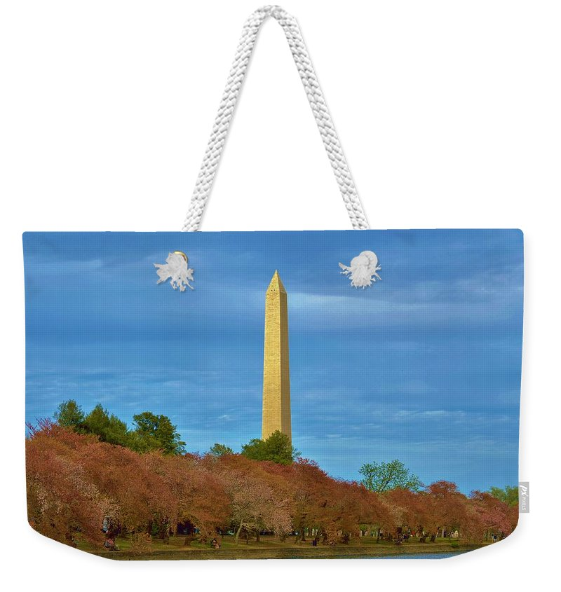 Weekender Tote Bag featuring the photograph Monument Blossoms, Japanese Cherry Blossom Trees With The Washington Monument In The Background by William Bartholomew