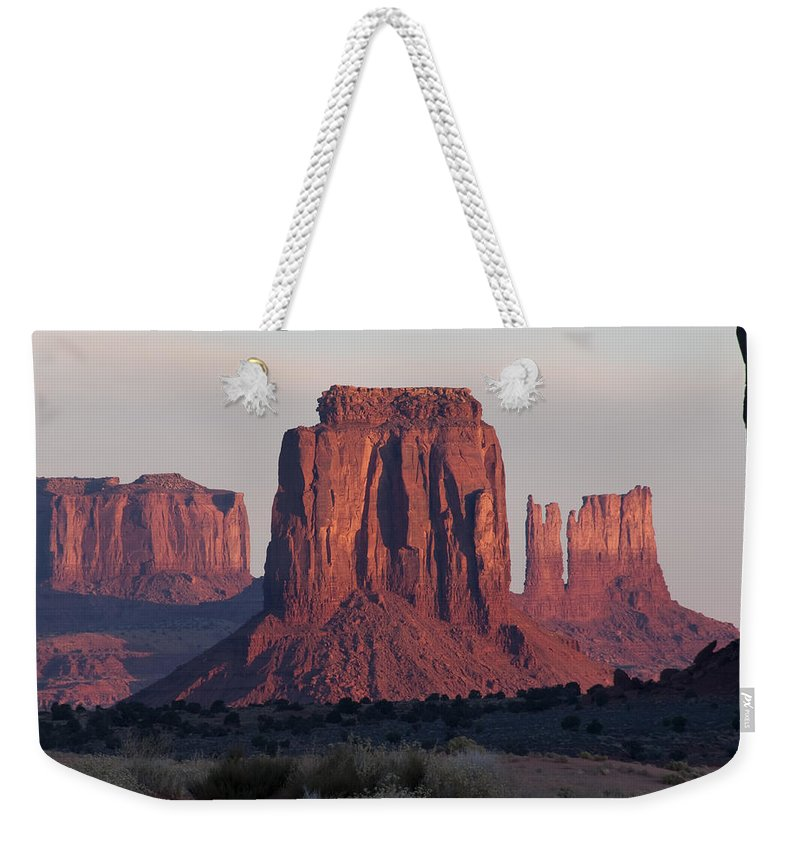 Monument Weekender Tote Bag featuring the photograph Monument Valley Sunrise 7288 by Bob Neiman