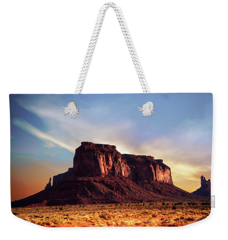 Monument Valley Weekender Tote Bag featuring the photograph Monument Valley sunset by Roy Nierdieck