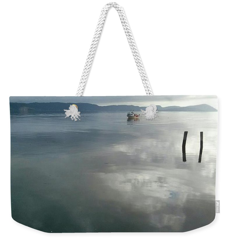 Weekender Tote Bag featuring the photograph Moody by Maria Verdicchio