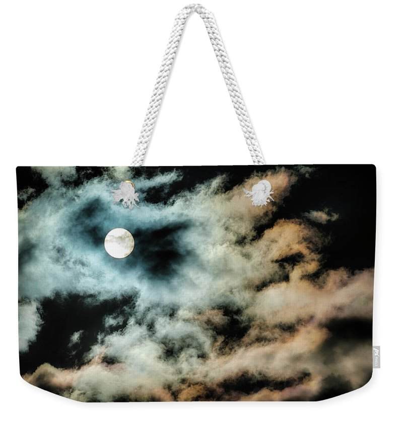 Sky Weekender Tote Bag featuring the photograph Moody Orb by Dee Browning