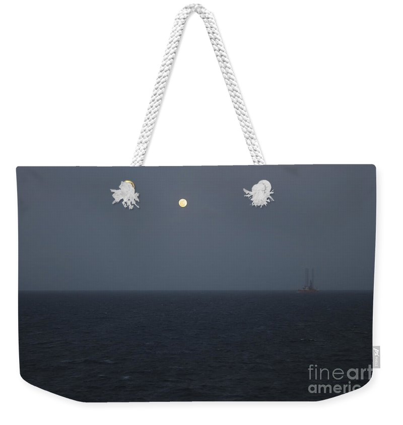 Moon Weekender Tote Bag featuring the photograph Moon At Sea by Clay Cofer