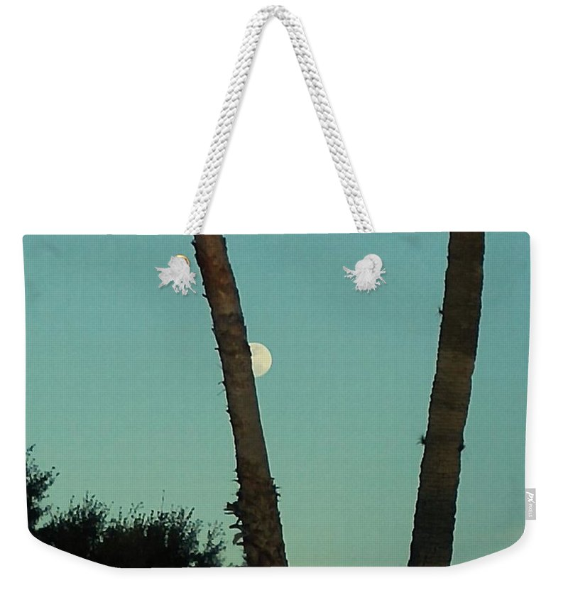 Weekender Tote Bag featuring the photograph Moon Hiding Behind The Palm by Miriam Marrero