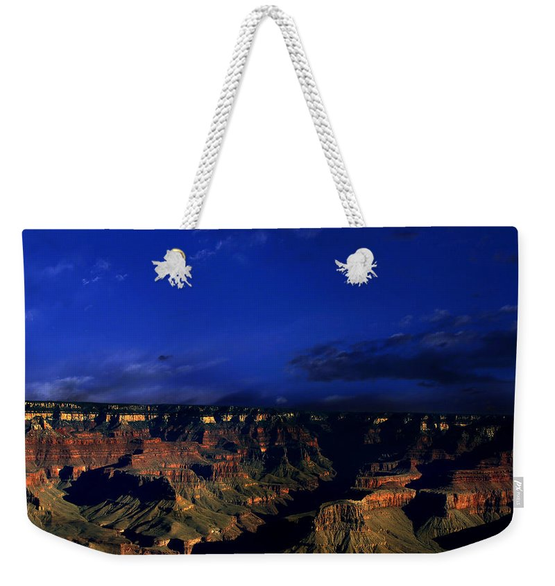 Grand Canyon Weekender Tote Bag featuring the photograph Moon Over The Canyon by Anthony Jones