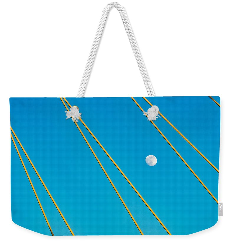 Dallas Weekender Tote Bag featuring the photograph Moon Through The Wires by Dan Leffel