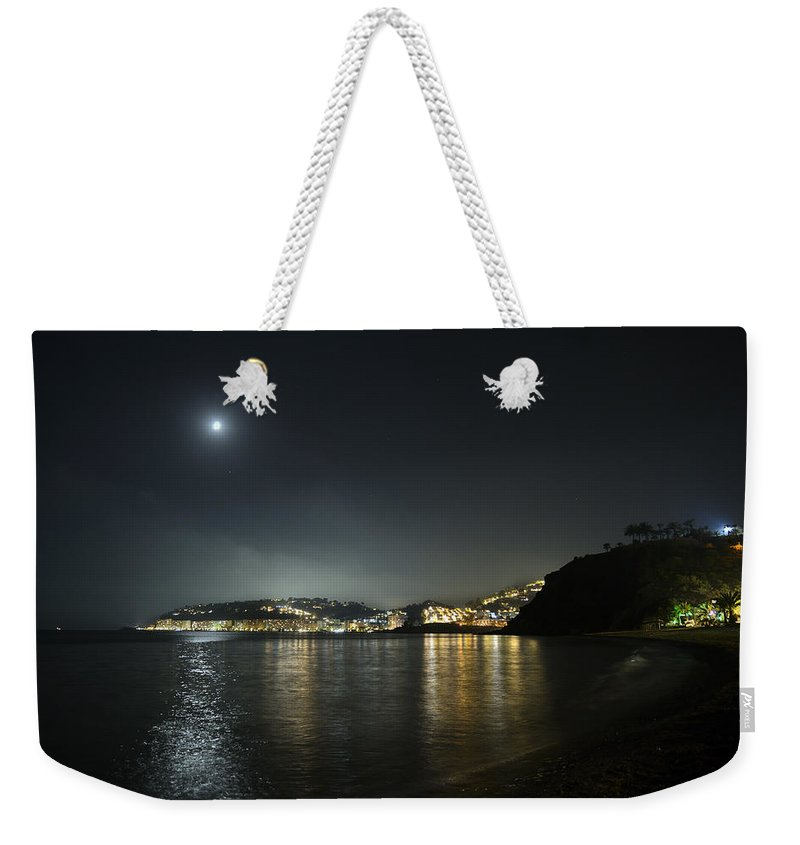 Moon Weekender Tote Bag featuring the photograph Moonlight At Granada Coast by Guido Montanes Castillo