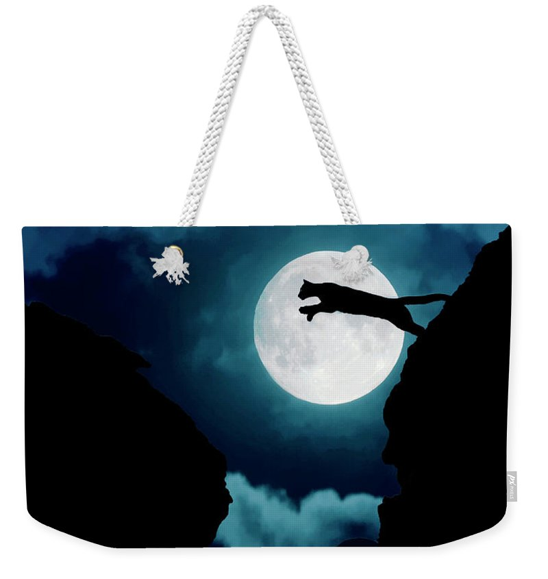 Mountain Lion Weekender Tote Bag featuring the photograph Moonlight Leap by Roy Nierdieck